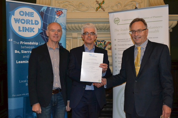 Clive Harridge (Secretary-General, Commonwealth Association of Planners and Warwickshire resident) presents the Award certificate to John Archer and Philip Clarke from One World Link at the Town Hall, Leamington Spa.